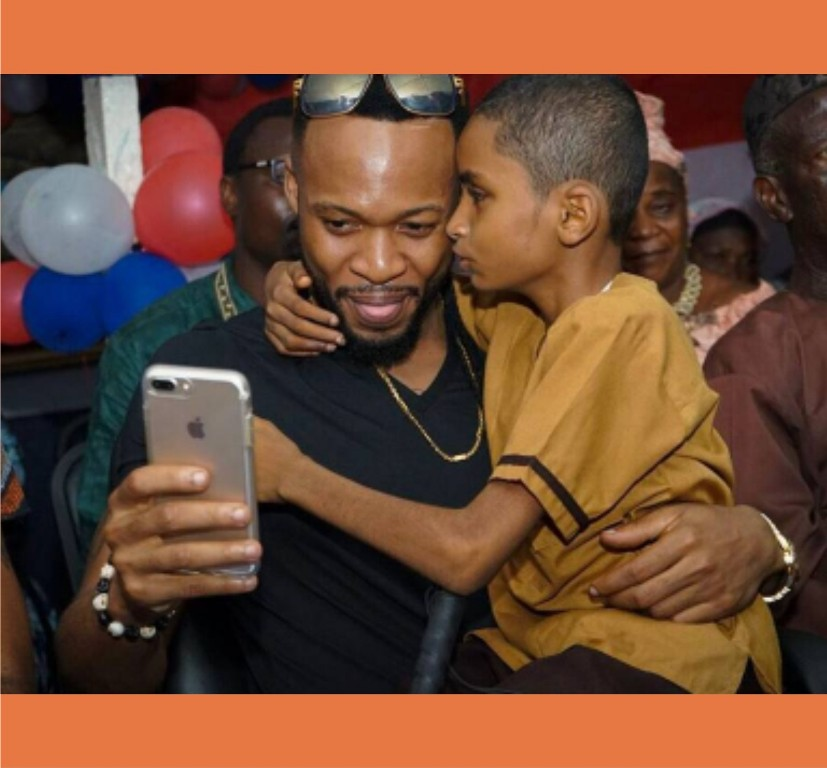 Singer Flavour Celebrates Semah, the blind boy he adopted