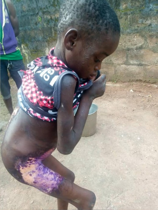 lady pours hot water on girl for licking milk