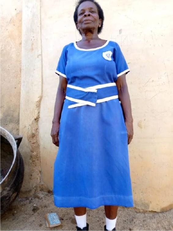 woman graduates from Junior Secondary